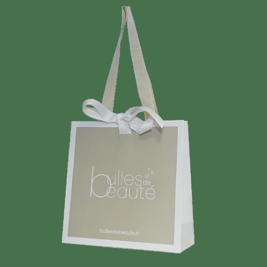 Sac papier luxe personnalisé avec poignées rubans et ruban intégré